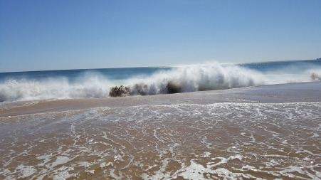 Waves crashing on Alvor South beach
