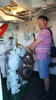 At the helm on HMS Cavalier (Not on the open bridge though..)