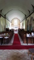 The interior of St Peters, Theberton. Note the bow, and the painted arches