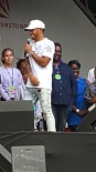 Lewis Hamilton with his family onstage