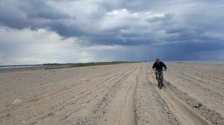 Cycling across the sandy causeway to Spurn Head at low tide